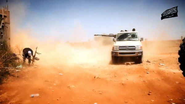 An image taken from a video by by Benghazi-based Islamist Ansar al-Sharia group allegedly shows Ansar al-Sharia militants during battle in Benghazi.