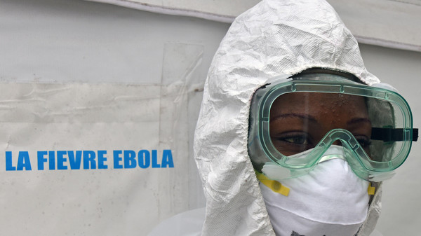 A health worker poses inside a tent in the Ebola treatment unit being preventively set to host potential Ebola patients at the University Hospital of Yopougon, on Oct. 17, 2014.