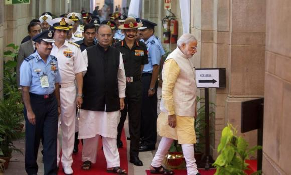 "Indian Prime Minister, Narendra Modi, right, leads officers of the Indian army, navy and air force for ""Combined Commanders"" conference in New Delhi, India, Friday, Oct. 17, 2014. Modi will interact with the country's top military officials for the first time at the conference and is expected to outline his strategic vision as well as get a briefing on the overall security situation. Following Modi, from left to right are, Indian Air Force chief Arup Raha, navy chief D.K. Joshi, Indian Defense Minister Arun Jaitley and Indian Army chief Dalbir Singh Suhag."