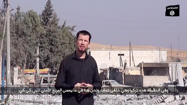 A video released by ISIS purportedly shows 43-year-old kidnapped British reporter John Cantlie.