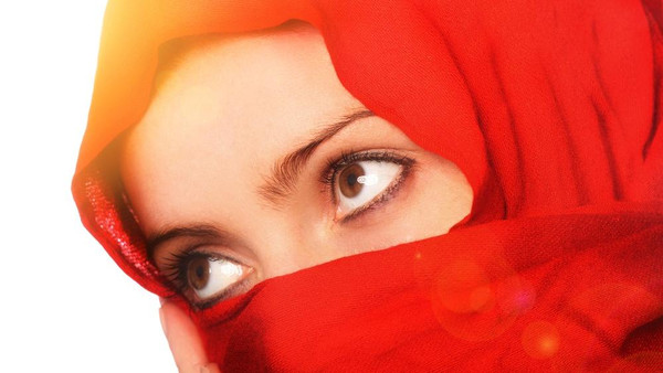 Australia's opposition welcomed lifting face veil ban for Muslim women and demanded an explanation for it.