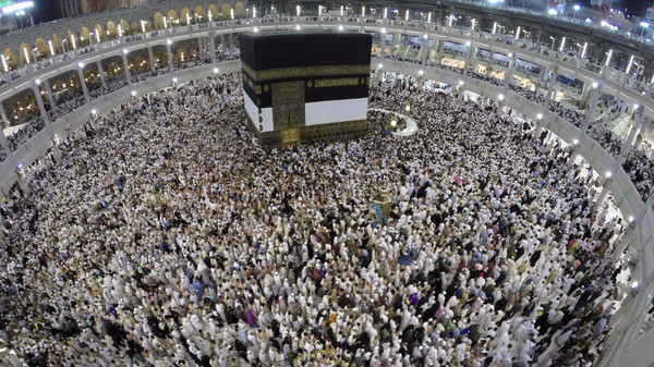 Muslim pilgrims pray around the holy Kaaba at the Grand Mosque, during the annual hajj pilgrimage in Mecca September 30 2014.