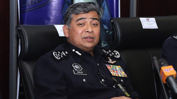 Malaysian national police chief Khalid Abu Bakar said 13 Malaysians were arrested in a raid on a restaurant in a Kuala Lumpur suburb.