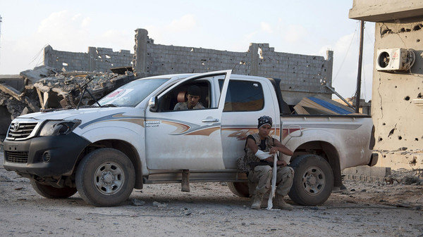 Members of forces loyal to former general Khalifa Haftar sit in and near a truck in the Benina area, east of Benghazi October 24, 2014.