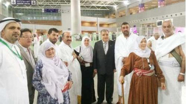 Palestine Consul General Emad Shaat with Palestinian pilgrims