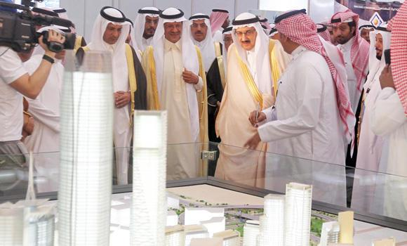 Municipal and Rural Affairs Minister Prince Mansour bin Miteb (3rd from right) is shown a model of thermally insulated buildings during the opening of the Saudi Energy Efficiency Forum and Exhibition 2014, being held at the Riyadh International Convention and Exhibition Center.
