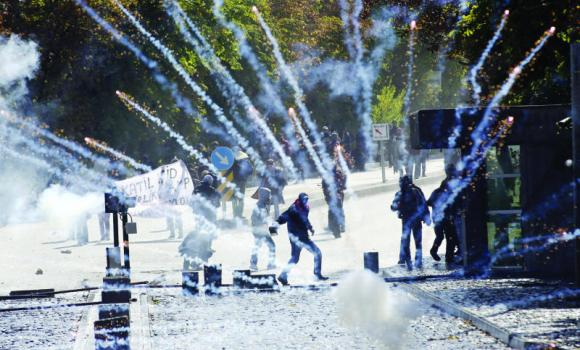 Protesters clash with riot police in Ankara on Thursday to denounce Turkey's unwillingness to intervene militarily against Islamic State forces in Kobani. Turkish President Recep Tayyip Erdogan said the protests are aimed at sabotaging the fragile peace process between Kurdish rebels and Ankara.