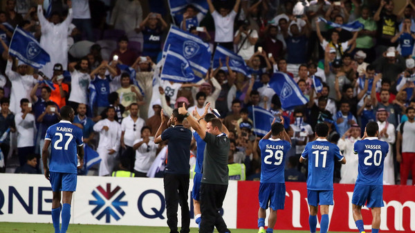 Saudi Al-Hilal players celebrate after defeating UAE's al-Ain during their AFC Champions League semi-final football match on September 30, 2014.