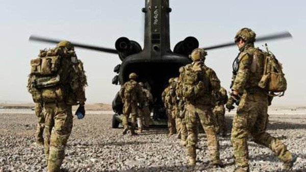 The 200 special forces troops are unable to reach Iraq due to Baghdad's 'excruciating inefficiency,' an Australian daily said.