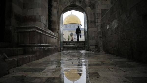 A visitor walks toward the Dome of the Rock as he enters the compound known to Muslims as Noble Sanctuary and to Jews as Temple Mount, in Jerusalem's Old City Oct. 19, 2014.