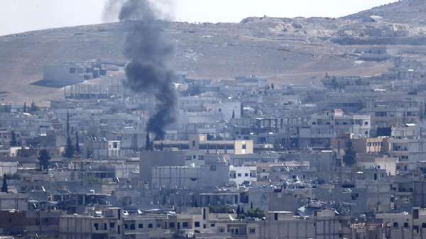 Smoke rises over the Syrian town of Kobane near the Mursitpinar border crossing, on the Turkish-Syrian border, as seen from the southeastern town of Suruc in Sanliurfa province October 24, 2014.