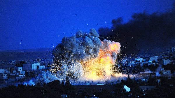 Smoke and flames rise following an explosion in the Syrian town of Kobane.