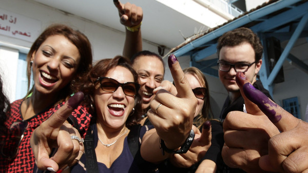 Tunisians show their ink-stained fingers after casting their votes, in Tunis October 26, 2014.