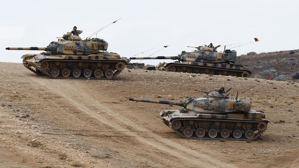 Turkish army tanks take up position on the Turkish-Syrian border near the southeastern town of Suruc in Sanliurfa province September 29, 2014.