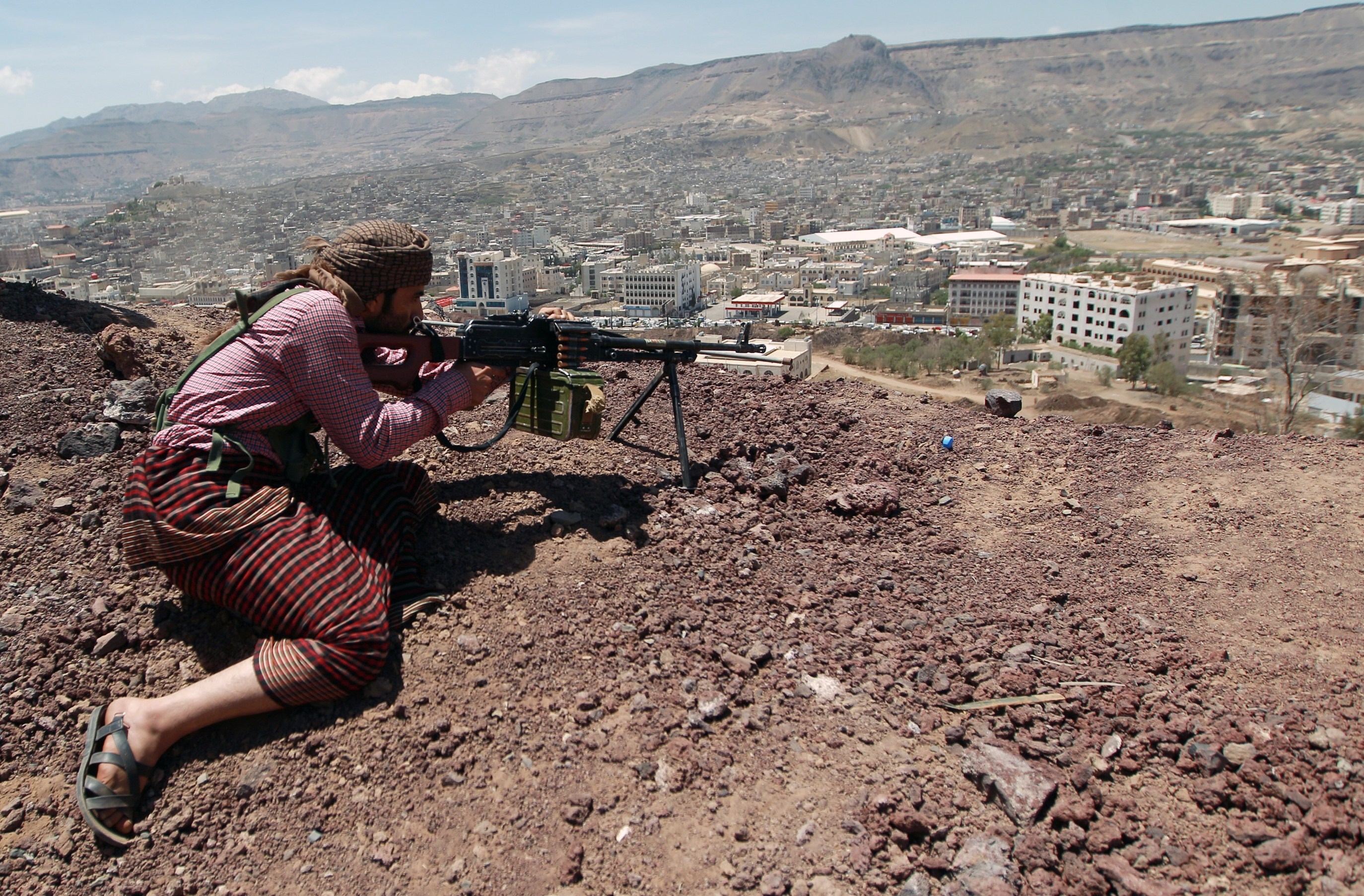 A Yemeni Shiite Huthi anti-government rebel holds a position at an army base which they captured without resistance just hours before the signing a UN-brokered peace agreement on September 22, 2014 in the Yemeni capital, Sanaa. The hard-won deal, signed the day before by the president and all the main political parties, is intended to end a week of deadly fighting in Sanaa between the rebels and their opponents, and put the country's troubled transition back on track.