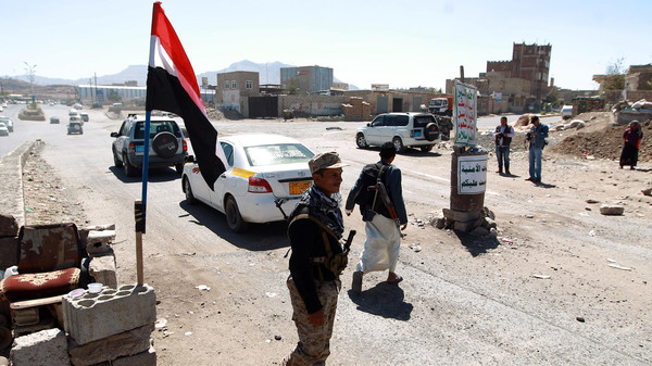 Yemeni gunmen loyal to the Shiite Houthi movement man a checkpoint in Sanaa.
