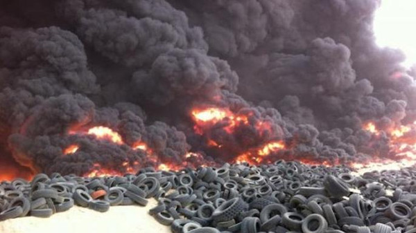 ISIS militants are reportedly setting dozens of old tires ablaze to create billows of smoke.