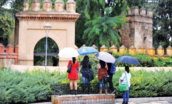 Tourists try to look over a fence at Los Jardines de Murillo that is to be one of the sets for the fifth season of the series Game of Thrones at the Reales Alcazares (royal palace) in Sevilla on Friday.