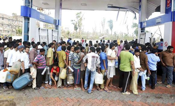 This Oct. 13, 2014 photo shows Indians lining up for fuel at a diesel pump after a cyclone in Vishakapatnam, India. India freed diesel prices from government control on Sunday while raising natural gas tariffs in the biggest-yet reform by Prime Minister Narendra Modi's government to overhaul the energy sector.