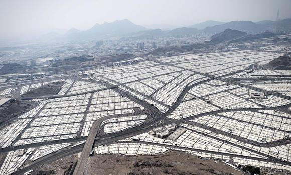 An aerial view shows tens of thousands of tents hosting pilgrims in Mina near the holy city of Makkah on Oct. 5, 2014. Plans are afoot to construct multistory buildings on Mina mountains as part of the efforts to accommodate more pilgrims in the tent city during Haj.