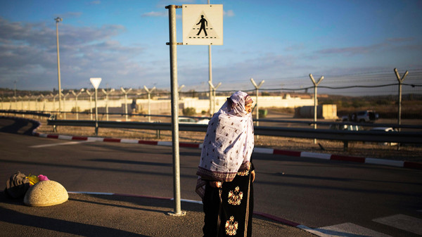 A Palestinian from Gaza waits after crossing into Israel through Erez Crossing.