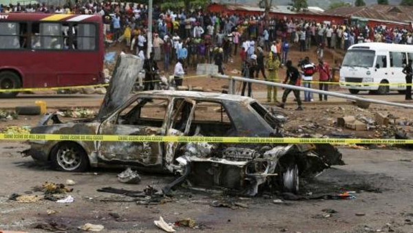 A damaged car is seen at the scene of a car bomb blast in Nyanya, Abuja in this file photo.