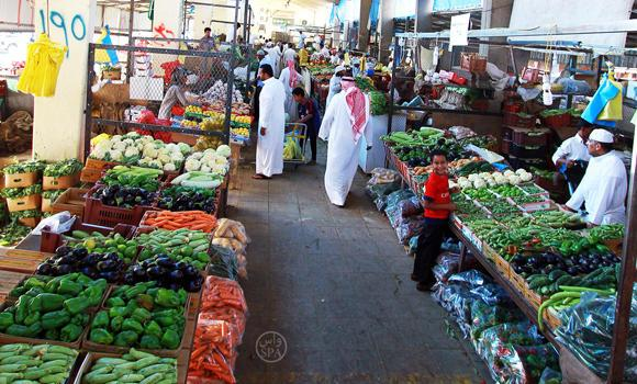 Saudis buy vegetables in a market in Al-Qassim. (SPA)