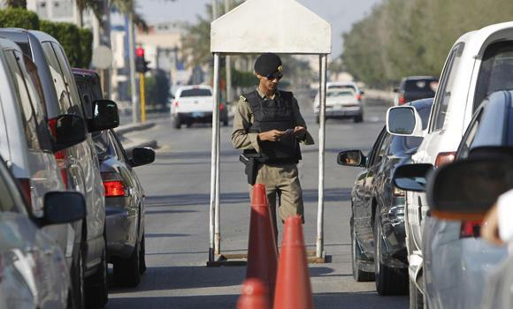 A security official mans a check post in Qatif.