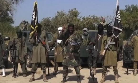 Extremist group Boko Haram Abubakar Shekau (C) delivering a speech.