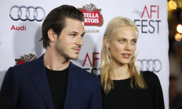 """Actors Gaspard Ulliel (L) and Aymeline Valade (R) pose at a special screening of """"Saint Laurent"""" during AFI Fest 2014 in Hollywood, California November 11, 2014."""