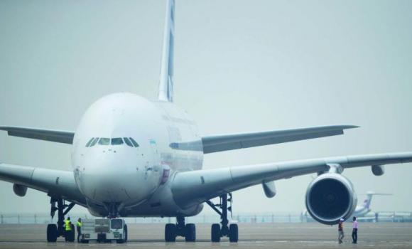 An Airbus A380 plane stands on the tarmac before taking off at the Airshow China 2014 in Zhuhai, south China's Guangdong province.