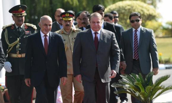 Afghan President Ashraf Ghani (2L) and Pakistani Prime Minister Nawaz Sharif (3R) arrive for a ceremony at the Prime Minister House in Islamabad on November 15, 2014.
