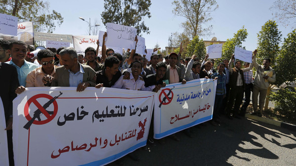 Students hold banners to demonstrate against the deployment of armed Houthi gunmen, at Sanaa University campus in Sanaa October 29, 2014.