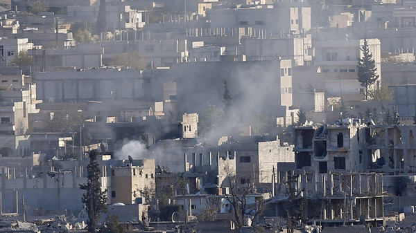A view shows smoke raising from an eastern Kobani neighbourhood, damaged by fighting between ISIS and Kurdish forces, November 18, 2014.
