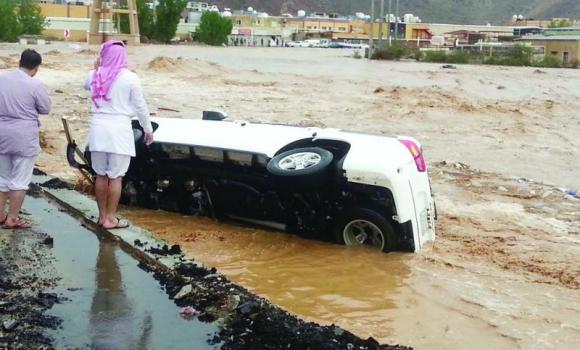 A car is capsized following flash floods in Makkah on Sunday. The Civil Defense Department in Makkah has stepped up efforts to save people from drowning. (SPA)
