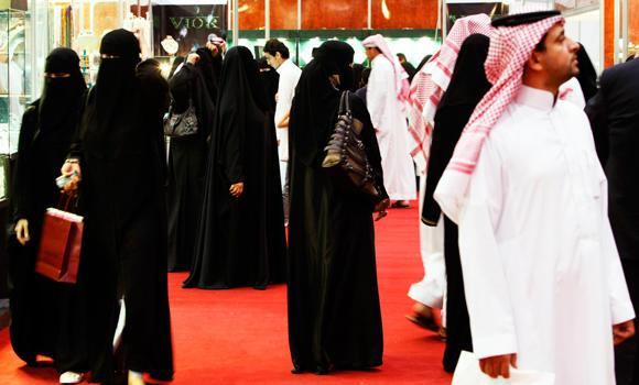 In this March 21, 2009 file photo, Saudis look at jewelry at a gold fair in Riyadh, Saudi Arabia.