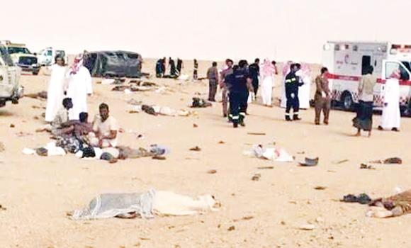Bodies and the wreckage lie scattered in the aftermath of the crash involving two vehicles along the Riyadh-Dawadmi Highway.
