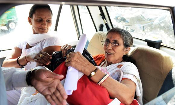 Indian Prime Minister Narendra Modi's wife, Jashodaben (R) holds a copy of the Right To Information (RTI) application filed by her as she leaves the Deputy Superintendent of Police (DSP) office in Mehsana, some 70 kms from Ahmedabad on Monday.