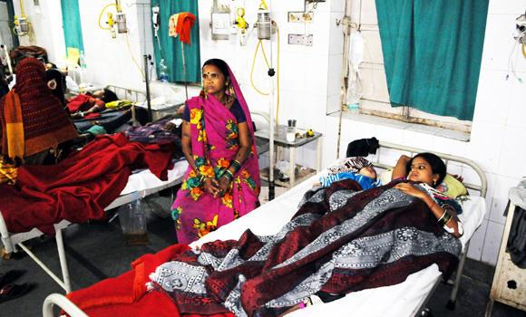 Indian women who underwent sterilization surgeries receive treatment at the CIMS hospital in Bilaspur, in the central Indian state of Chhattisgarh, on Tuesday.