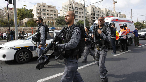 Israeli police officers walk at the scene of an attack in Jerusalem November 5, 2014.