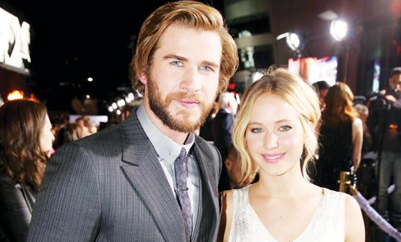 Liam Hemsworth, left, and Jennifer Lawrence.
