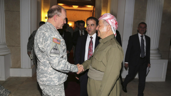 Iraqi Kurdish regional President Masoud Barzani (R) meets with Chairman of the Joint Chiefs, U.S. Army General Martin Dempsey in Erbil, north of Baghdad, November 15, 2014.