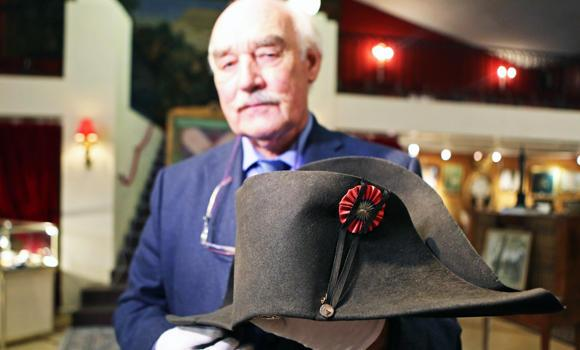 Napoleon expert Jean Claude Dey presents Napoleon's hat, from the Napoleonic collection of the Palais de Monaco, in Fontainebleau, south of Paris, France, in this Nov. 12, 2014 photo.