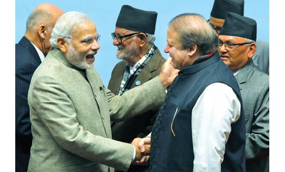 Pakistani Premier Nawaz Sharif, right, and his Indian counterpart Narendra Modi shake hands during the closing session of the 18th SAARC summit in Katmandu.