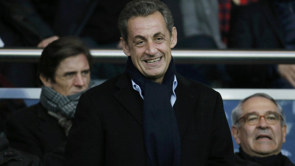 Former French president Nicolas Sarkozy attends the French Ligue 1 soccer match between Paris St Germain and Nice at the Parc des Princes Stadium in Paris November 29, 2014.