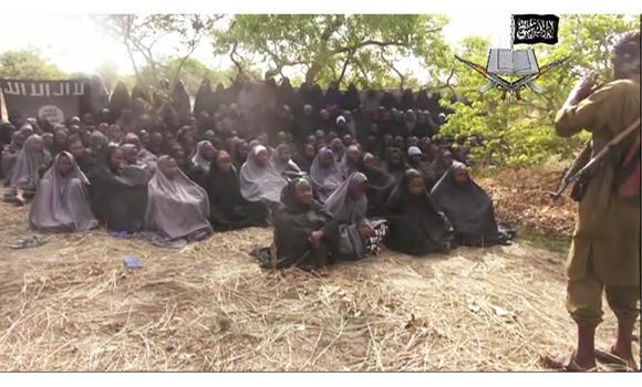 This May 12, 2014, file image taken from video by Nigeria's Boko Haram terrorist network, shows the girls abducted from the northeastern town of Chibok. In their latest atrocity, Boko Haram gunmen reportedly killed 48 fish vendors in Nigeria's restive Borno State on Sunday.