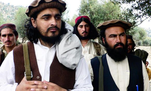 In this Oct. 4, 2009 file photo, Pakistani Taliban chief Hakimullah Mehsud, left, is seen with his comrade Waliur Rehman during his meeting with media in Sararogha, a Pakistani tribal area of South Waziristan along the Afghanistan border.