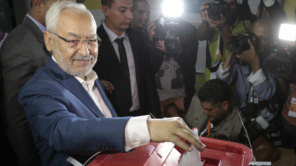 Rached Ghannouchi, leader of the Islamist party Ennahda, casts his vote at a polling station in Tunis Oct.26, 2014 during parliamentary elections four years after the revolution that cast out autocrat Zine al-Abidine Ben Ali.