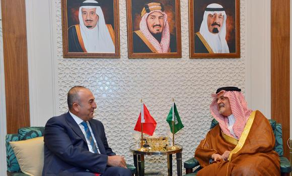 Saudi Arabia's Foreign Minister Saud Al-Faisal, right, talks with Turkish counterpart Mevlut Cavusoglu in Riyadh, Saudi Arabia.