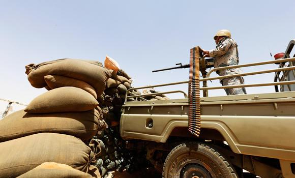 A member of the Saudi border guards force man a machine gun mounted on a military truck positioned on Saudi Arabia's northern borderline with Iraq, in this July 14, 2014 photo.